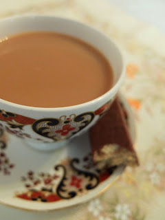 A cup of tea with a Tunnocks caramel wafer