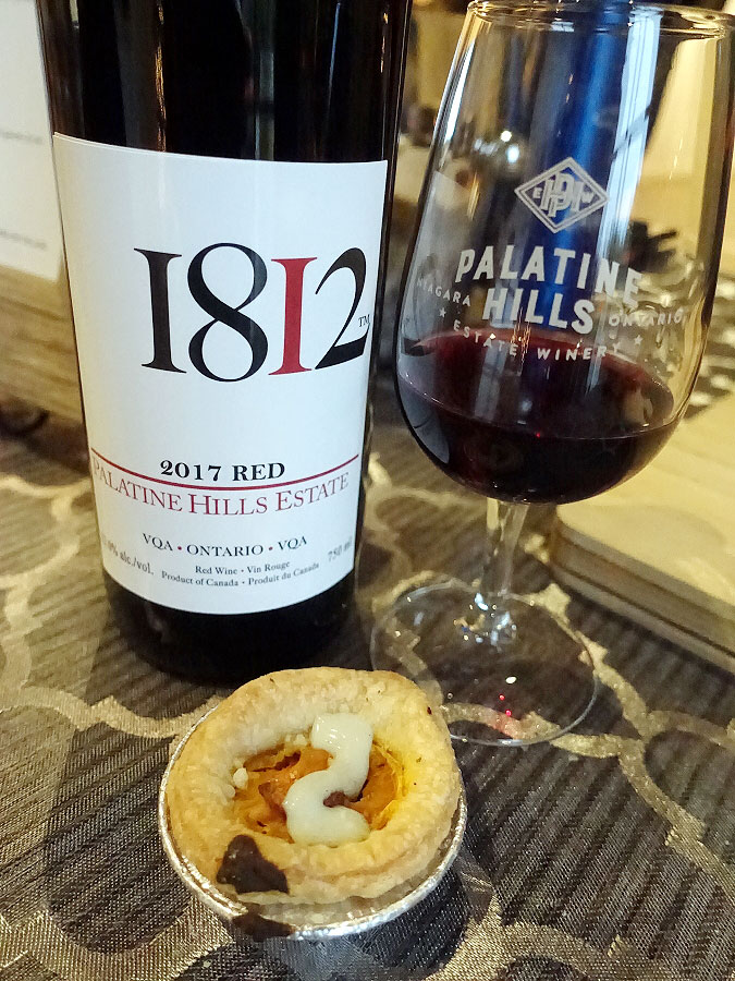 Palatine Hills 1812 Red 2017 (87 pts) with spicy Buffalo chicken featuring creamy chicken, carrots and celery in flaky pastry drizzled with blue cheese aioli