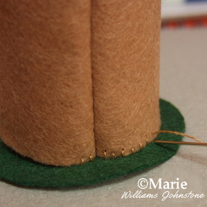 Sewing the parts of felt together