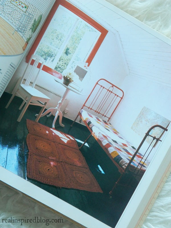 A humorous look back at decorating styles from the 1980's using Mary Gialliatt's, The Decorating Book, as the source material.  A farmhouse cottage bedroom with red pops of color.