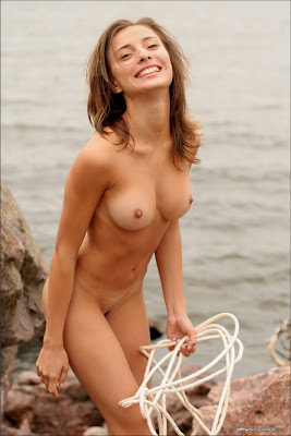 Naked Brunette Bound With Rope On The Cliff
