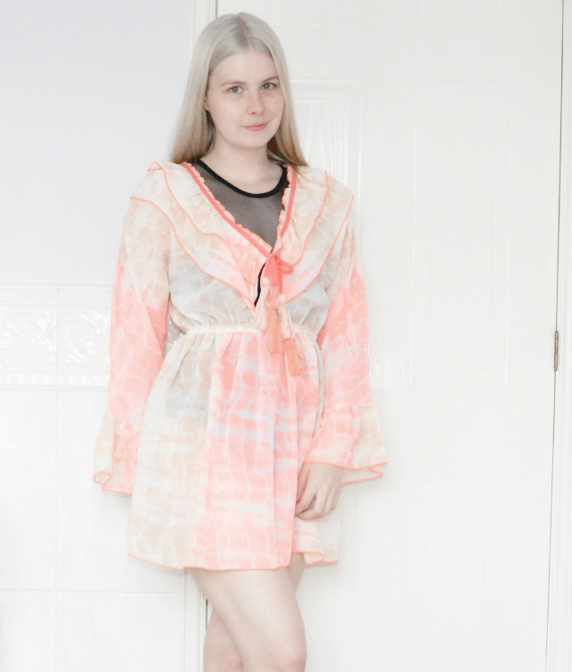 Blonde girl wearing coral tie dye beach cover up