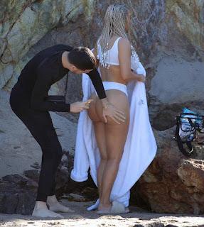 Kim Kardashian bares her famous butt in topless beach shoot