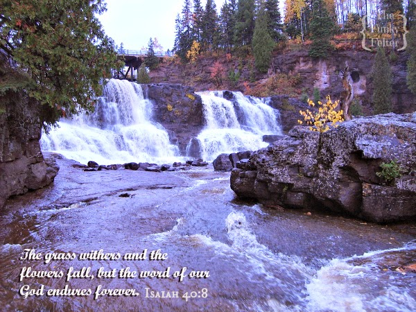 isaiah 40:8 fall bible verse with waterfall and foliage photo by the funky felter