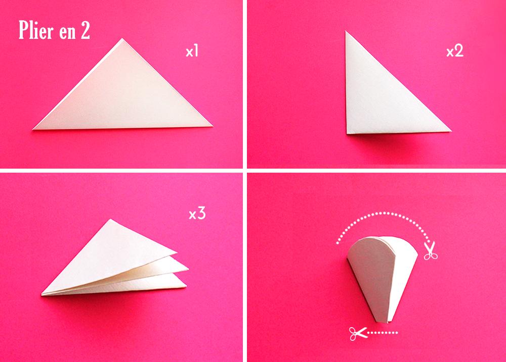 papier plié étape par étape sur un fond rose