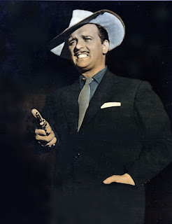 Fred Buscaglione sports the 'gangster' look for which he was famous in the film I ladri (1959)