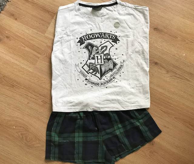 Green tartan shorts and grey t-shirt with Hogwart crest on ladies Pjs