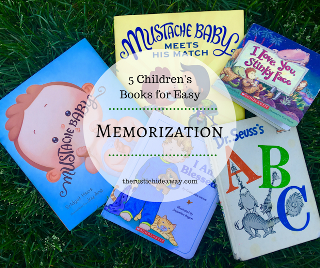 Image of 5 children's books laying on grass