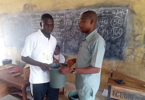 Teaching Practice students gifted plastic buckets by Headmaster during their send forth in Abuja