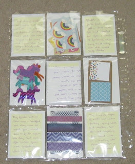 stickers, unicorn foam stickers, mini notepads, and washi samples