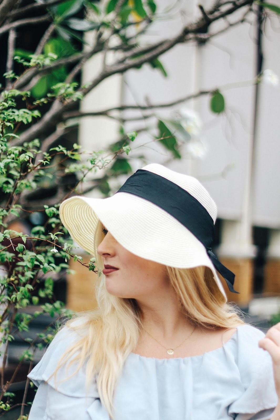 Fashion and Travel Blogger GlobalFashionGal (Brianna Degaston) wearing a floppy hat at Railay Beach, Thailand.