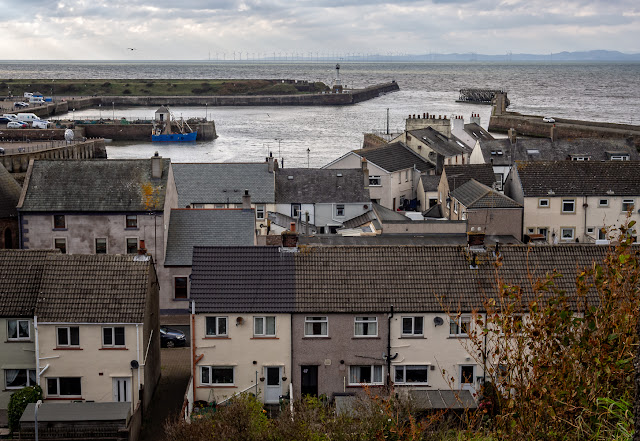 Photo of looking out over Maryport rooftops to the Solway Firth