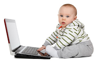 Baby typing on computer