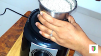 image of grinding narial in mixy jar