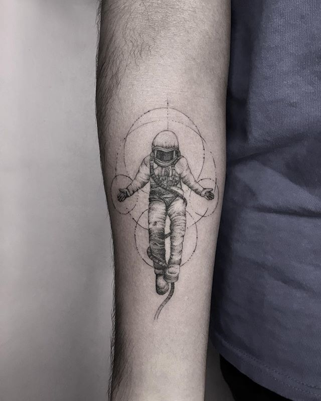 astronaut fly in space tattoo