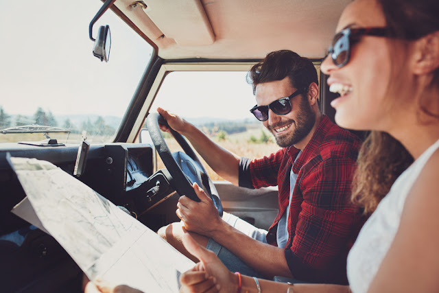 Couple planning their Iceland road trip itinerary