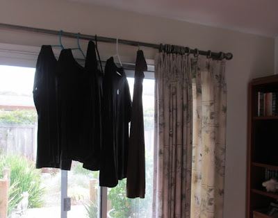 laundry hanging to dry on curtain rod