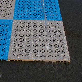Greatmats Staylock Perforated plastic tile with water