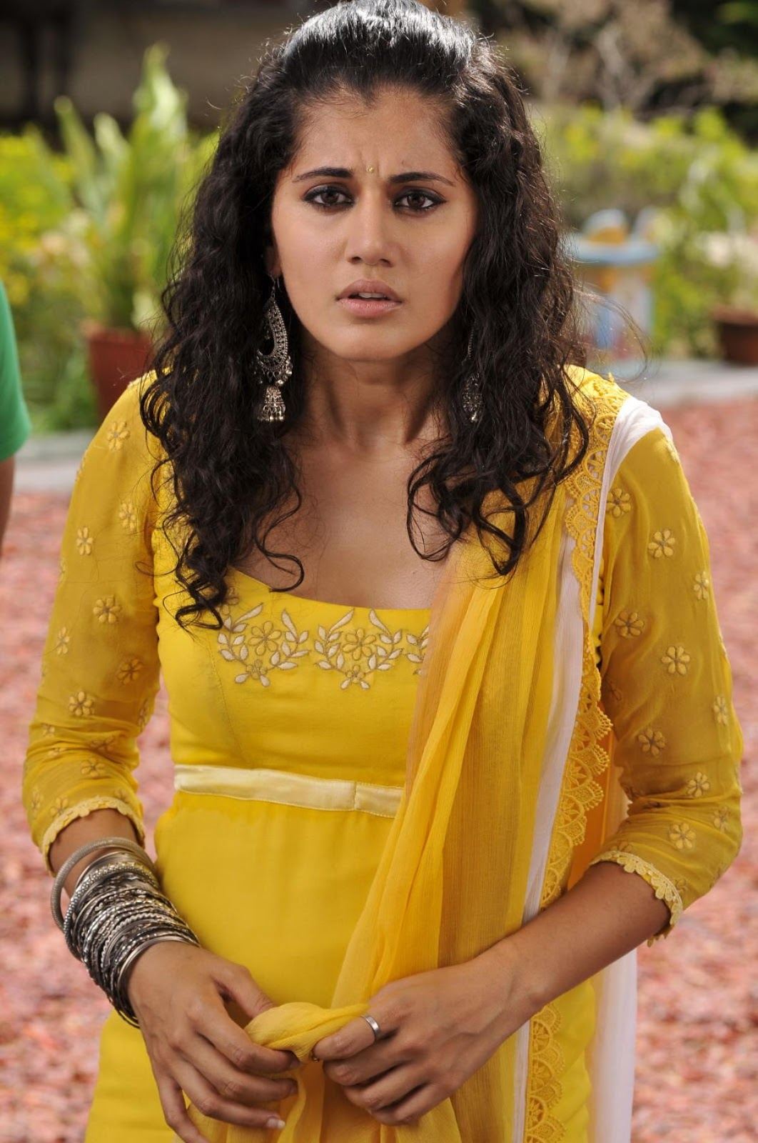 Glamorous Taapsee Hot Stills In Yellow Dress