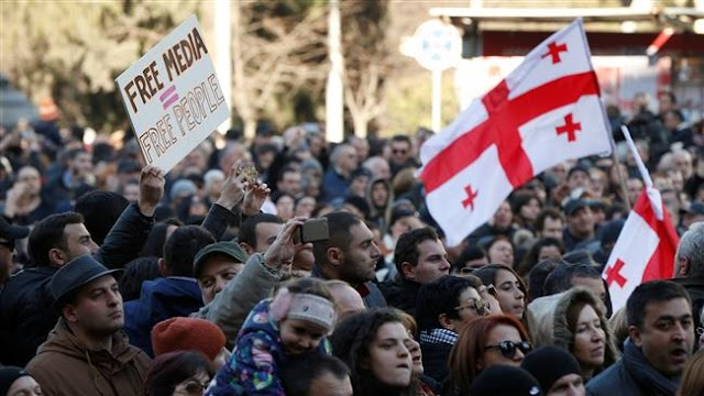 Georgians rally against government.'s alleged move to silence TV channel