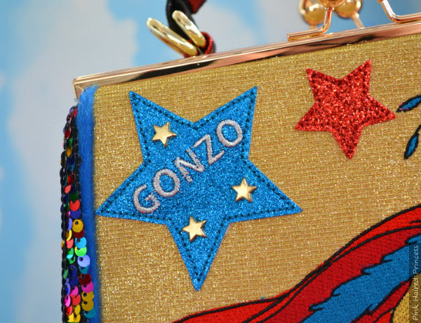 blue glitter applique embroidered Gonzo star on handbag