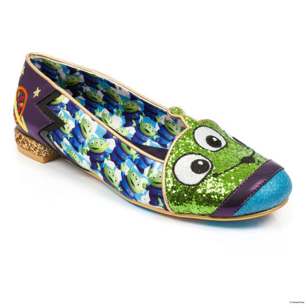 single shoe with Toy Story alien printed material, green glitter alien face across toe, sitting at an angle