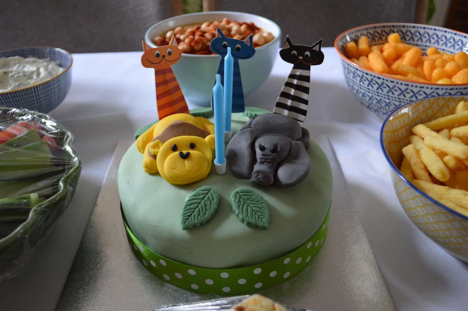 this is a picture of a cake with a lion and elephant topper