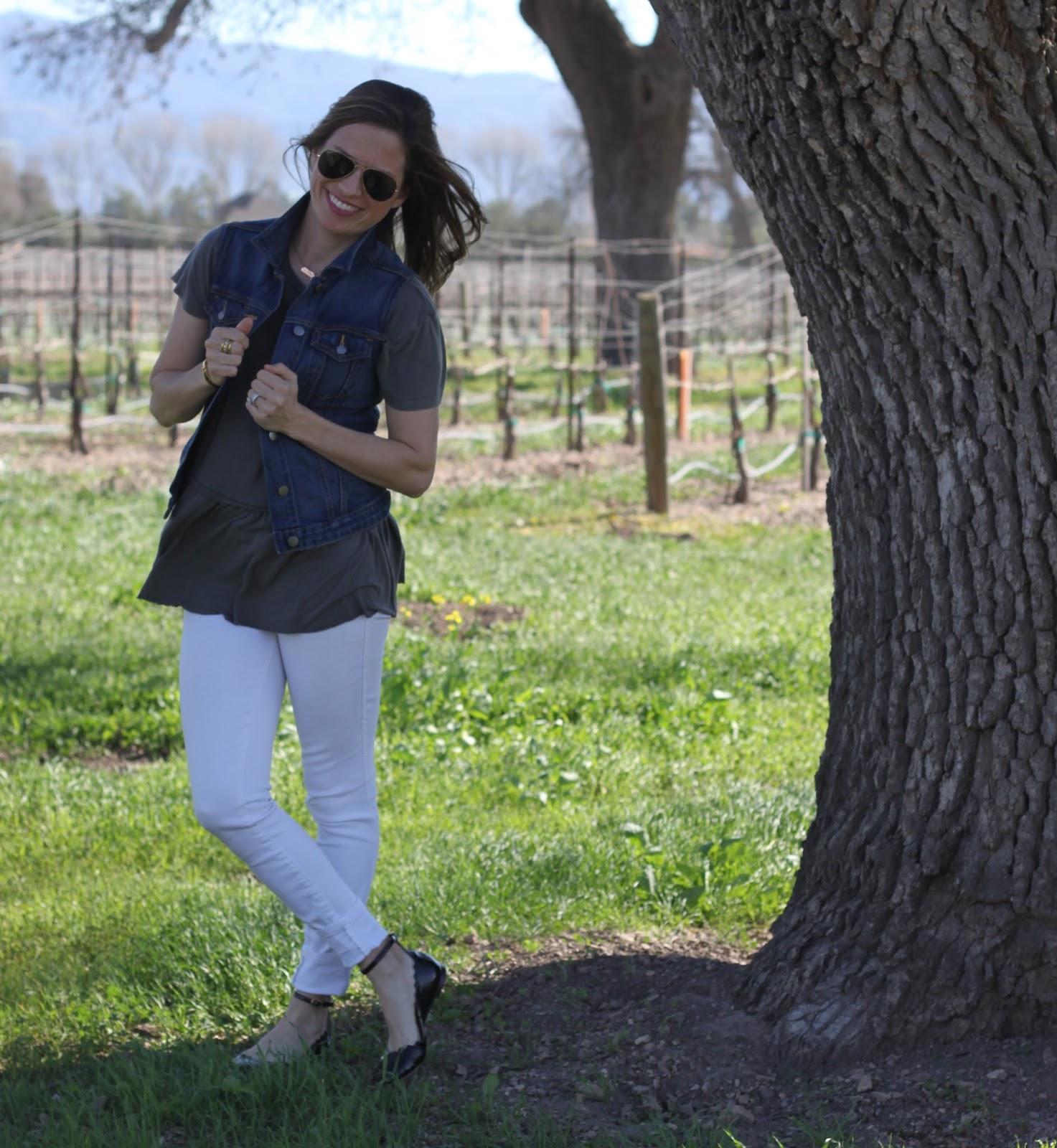 denim vest and white jeans