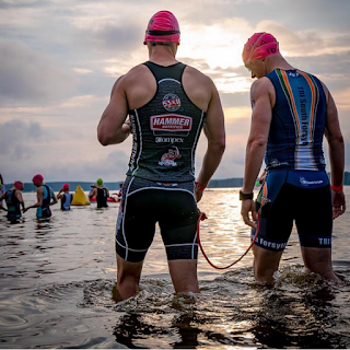 blind athlete and his guide as swim start, Ironman 70.3 Raleigh
