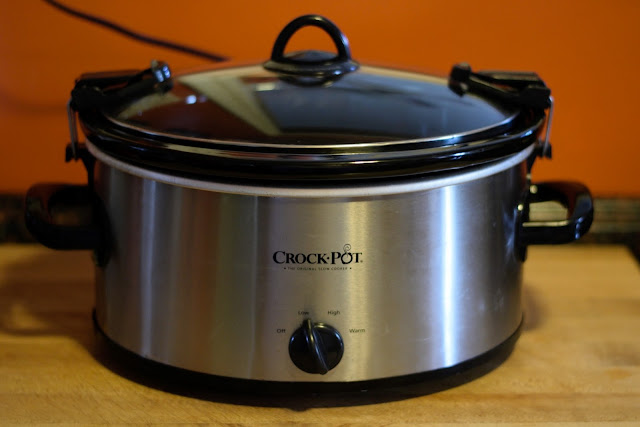 A crockpot on the counter.