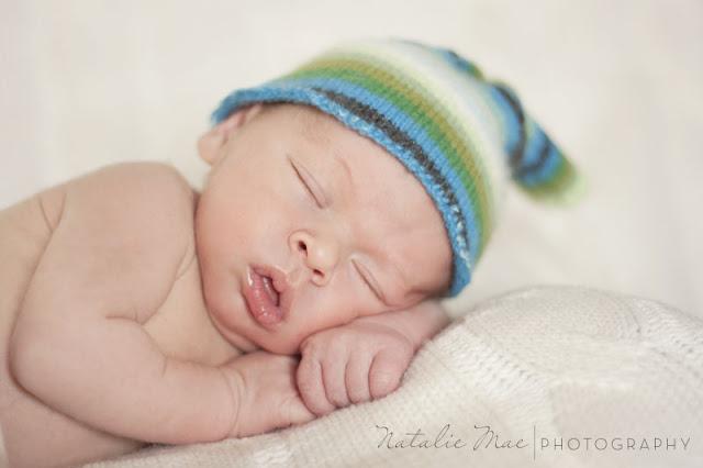 Sleepy baby Lucian strikes a pose.