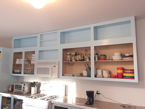 blue cabinets with white walls