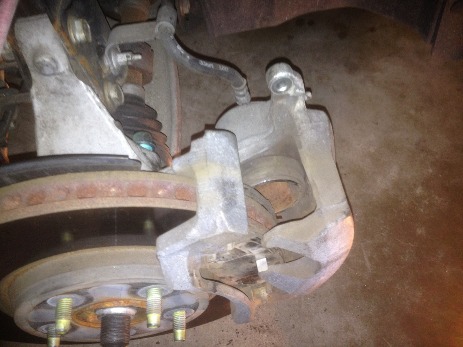 after caliper mounting bolts are removed slide the caliper forward then lift off the rotor and support with a bungee cord be sure the brake hose does not  [ 1600 x 1200 Pixel ]