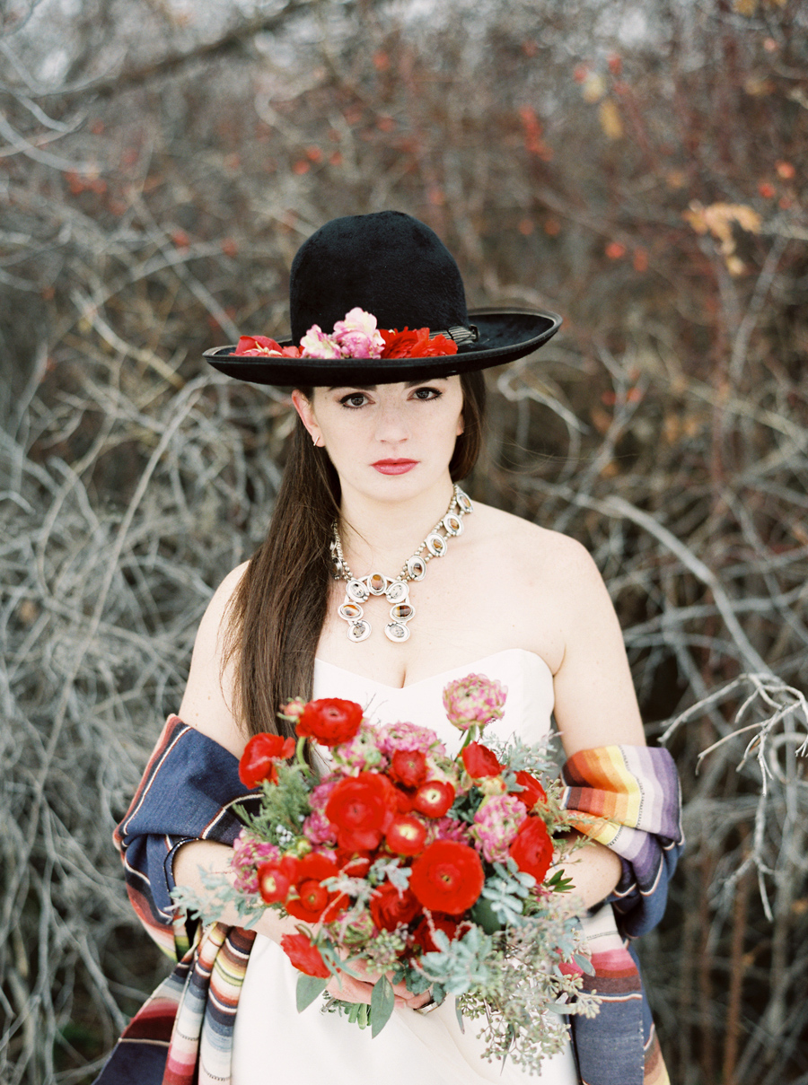 Vintage Hat - Wedding Style / Red Flowers / Photography: Orange Photographie / Styling & Flowers: Katalin Green / Hair & Makeup: Alexa Mae / Dress: Coren Moore / Hat & Serape: Vintage / Necklace & Ring: Mountainside Designs / Location: Bozeman, MT
