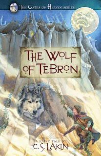 a man, a wolf, and a mountain are shown on the cover