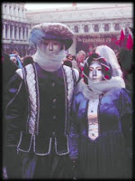 two characters in carnival costume