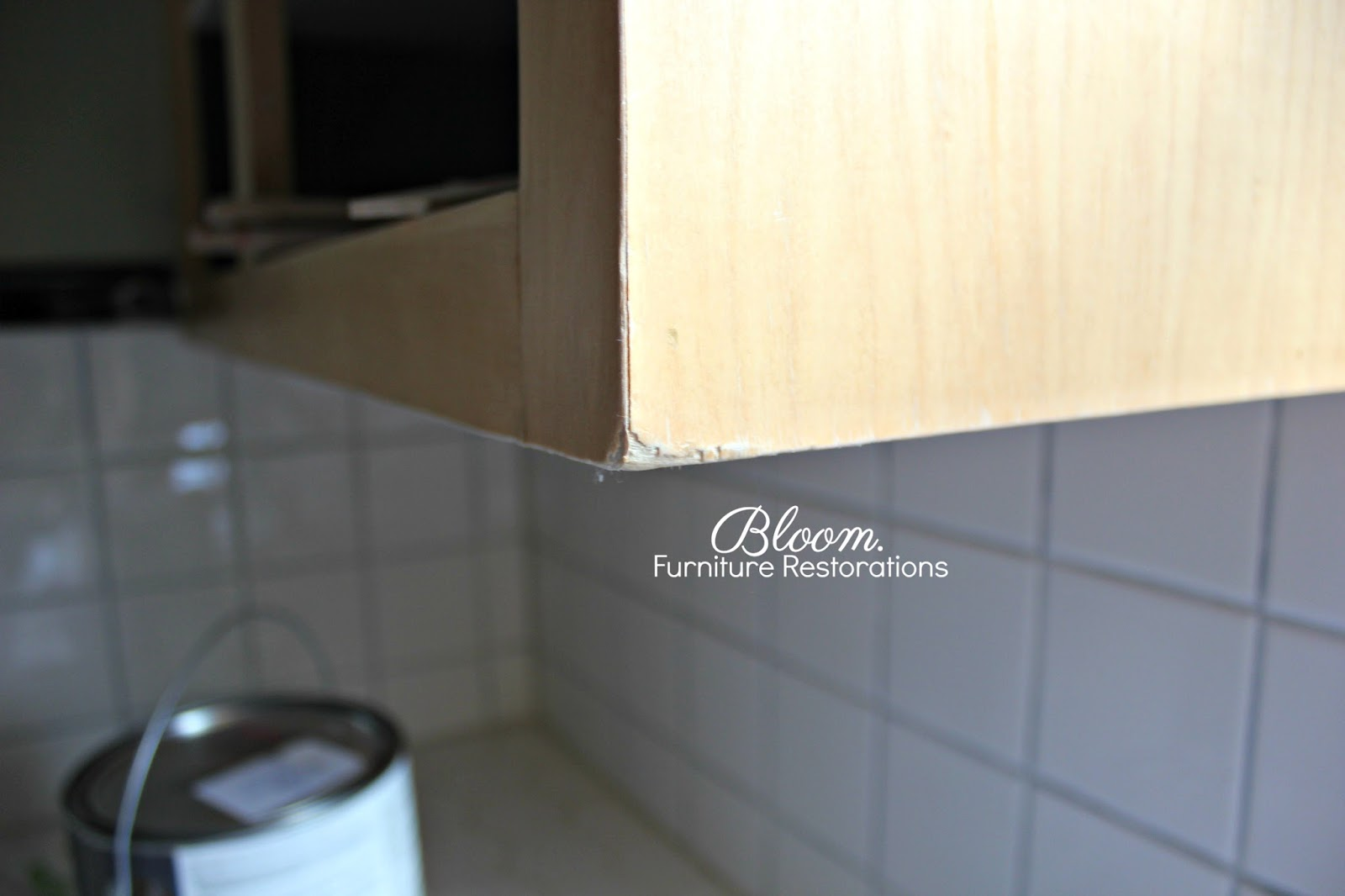 There Was Chipped Veneer At The Corner And Along Front Edge Of Cabinet Laminate Had Started To Pull Away