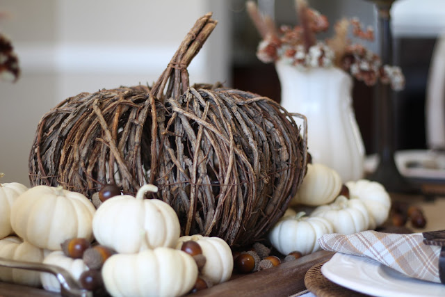 natural fall tablescape with willow pumpkin and white baby pumpkins