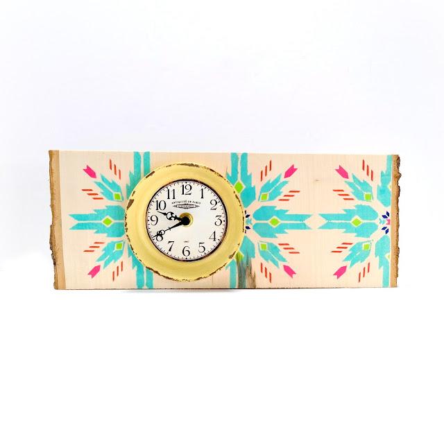 Stenciled Wood Slice Clock Decor with Vibrant Totem Print