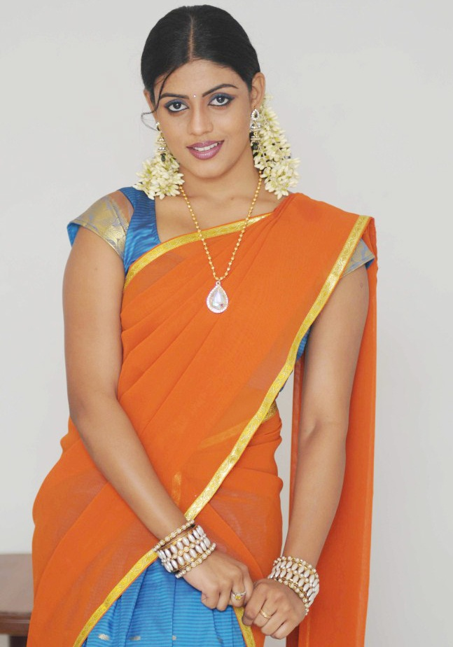 South Indian Hot Girl Iniya Photo shoot In Orange Half Saree