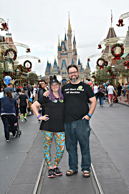 Celebrating my Birthday at the Magic Kingdom - Couple in front of Cinderella's Castle