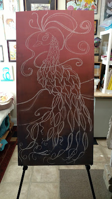 chalk drawing of a peacock on underlayment wood