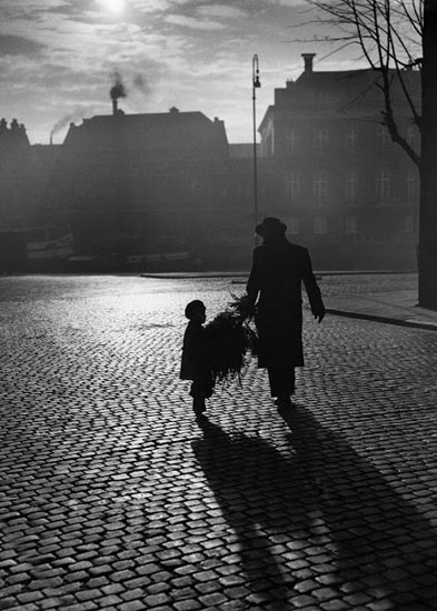 Father and son with a little Christmas tree, 1949