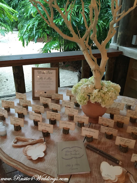 Guest Book Sign In Table Close-Up including Rustic Tree Branch Place Card Holders