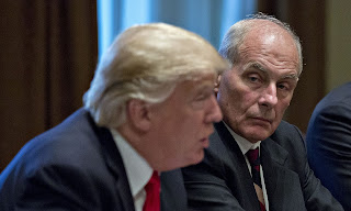 John Kelly, White House chief of staff, listens as U.S. President Donald Trump, left, speaks during a briefing with senior military leaders in the Cabinet Room of the White House in Washington, D.C. on October 5, 2017. (Photograph Credit: UPI / Barcroft Images) Click to Enlarge.