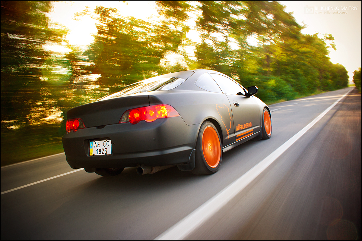 murdered out cars: Flat Black Acura RSX With Orange Wheels