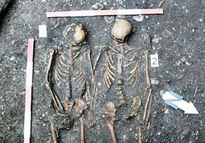 Skeletons of couple holding hands found in Romania