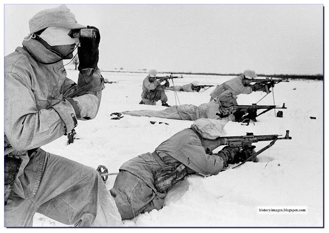 German soldiers, armed with assault rifles, StG-44 near Pripyat, Ukraine. February 1944