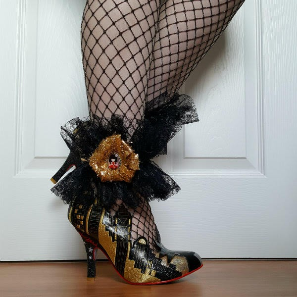 gold New York skyline shoes worn with fishnet tights and black lace ankle cuff