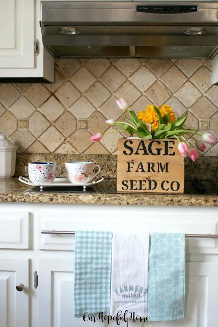 stencilled wood crate flowers tea cups tea towels